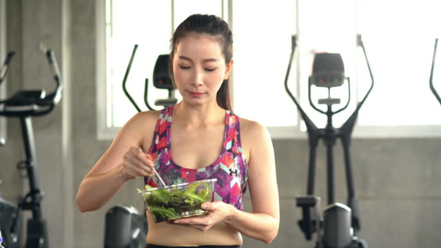 asian woman sporty eating salad box after workout, fresh and healthy food. - salad stock videos & royalty-free footage