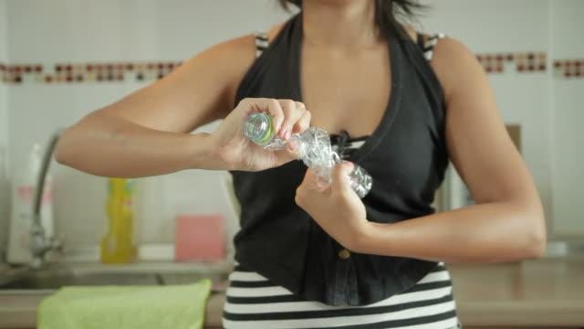 asiatische frau spanne die flaschen für das recycling bin verschiedenen szenen - zerdrückt stock-videos und b-roll-filmmaterial