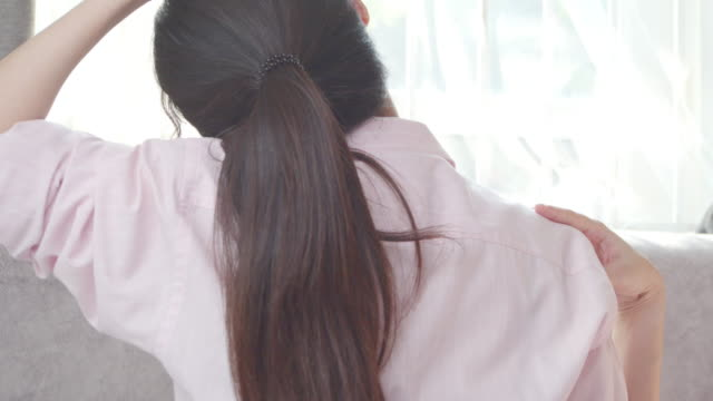 asian woman stretching on her neck.health care concept - osteoporosis stock videos & royalty-free footage