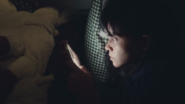 asian woman surfing the net on smartphone. - sleeping stock videos & royalty-free footage