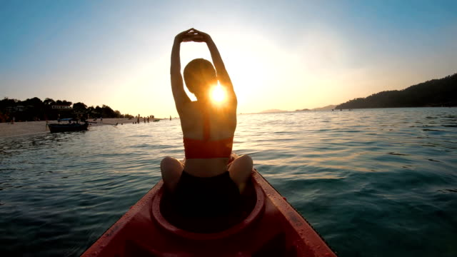 asian woman swims in the kayak in the sunset at lipe, satun, thailand - canoe stock videos & royalty-free footage