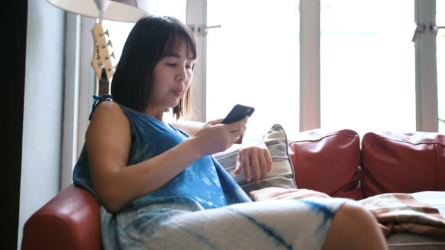 Asian woman texing on smart phone