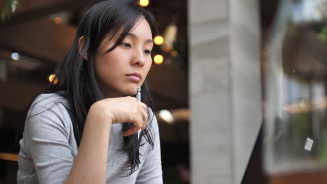asian woman thinking idea - concentration stock videos & royalty-free footage