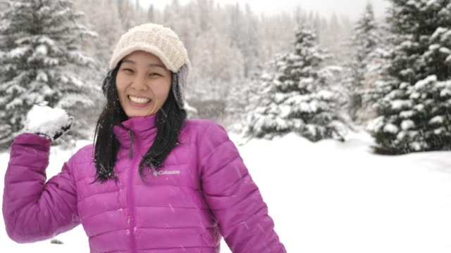 asian woman throwing snow ball into camera - throwing stock videos & royalty-free footage