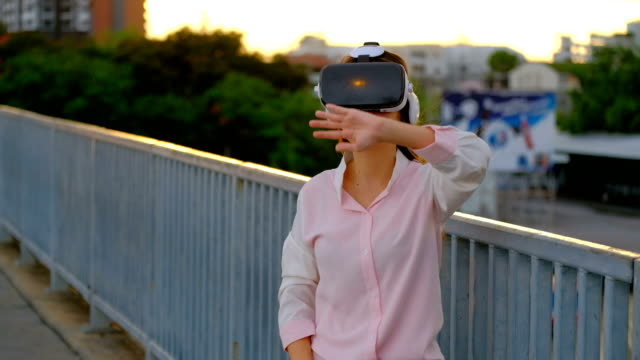 Asian Woman uses a virtual reality glasses
