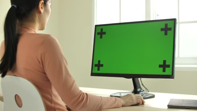 asian woman using computer with green screen at home, zoom in - computer monitor mockup stock videos & royalty-free footage