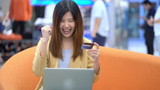 asian woman using credit card for shopping online - smart card stock videos & royalty-free footage