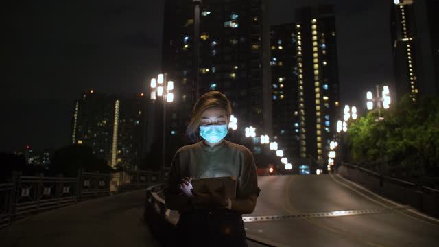asian woman using digital tablet at night after work - only teenage girls stock videos & royalty-free footage
