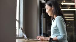 Asian Woman using laptop Computer
