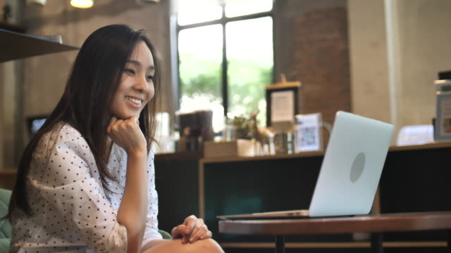 asian woman using laptop in cafe - using laptop stock videos & royalty-free footage