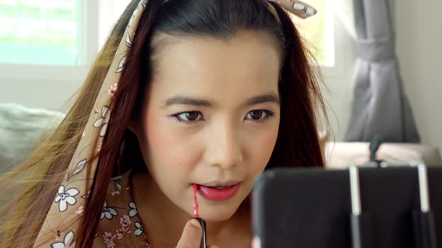 asian woman using pink lipstick - pink lipstick stock videos and b-roll footage