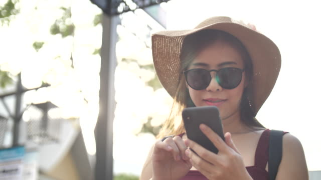 asian woman using smart phone - femininity stock videos & royalty-free footage