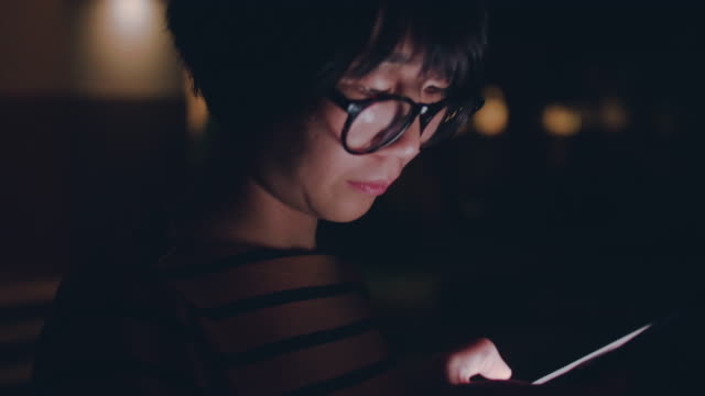 asian woman using smartphone, night. - electronic organizer stock videos and b-roll footage