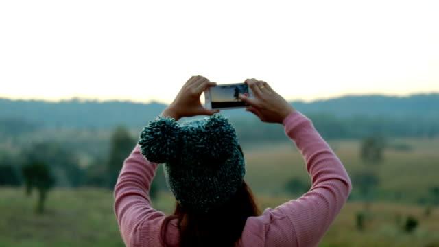 Asian woman using smartphone take a photo, Slow motion