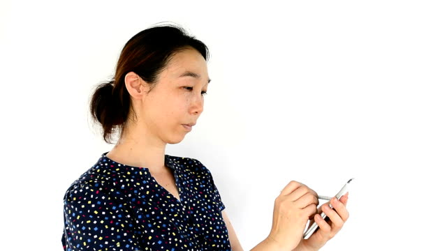 Asian woman using tablet-pc on white background