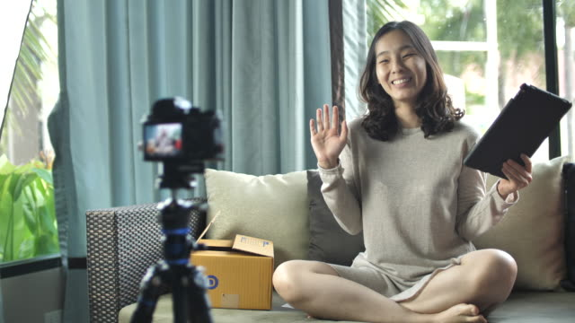 asian woman vlogger talking to camera - critic stock videos & royalty-free footage