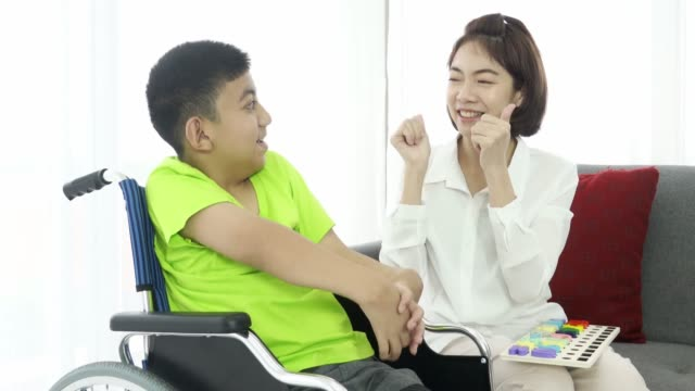 asian woman volunteer and cerebral palsy boy at disabled shelter - cerebral palsy stock videos & royalty-free footage