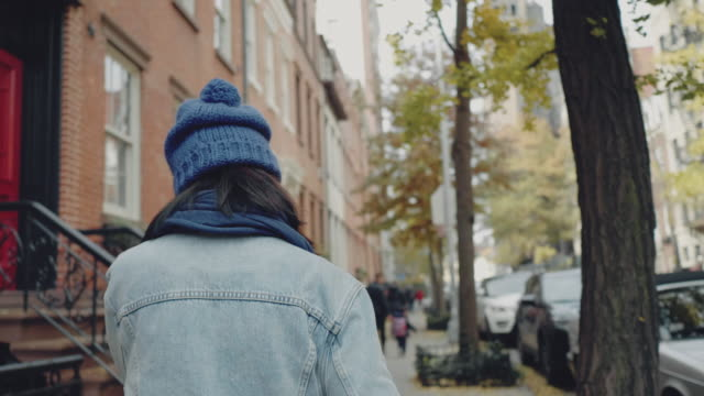 asian woman walking in manhattan city. - woolly hat stock videos and b-roll footage
