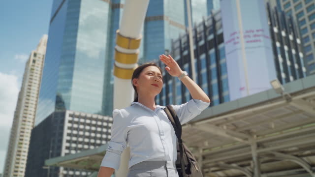 asian woman walking in the city slow motion - sunbeam stock videos & royalty-free footage