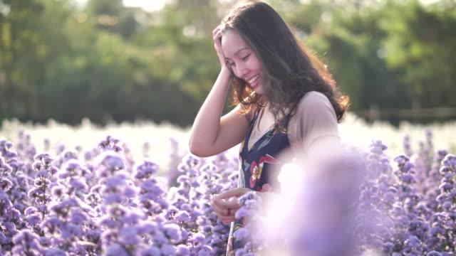 asian woman walking in the field of flower - herbal medicine stock videos & royalty-free footage