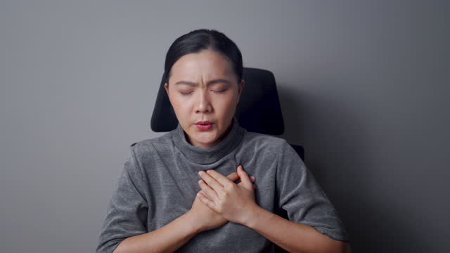 asian woman was chest pain isolated on background. - air raid stock videos & royalty-free footage