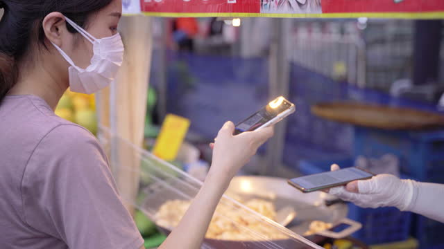 asian woman wear face mask buying a food at supermarket - equipment stock videos & royalty-free footage