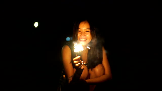 Asian Woman with a Sparkler