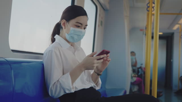 asian woman with hygiene mask. - public transport stock videos & royalty-free footage