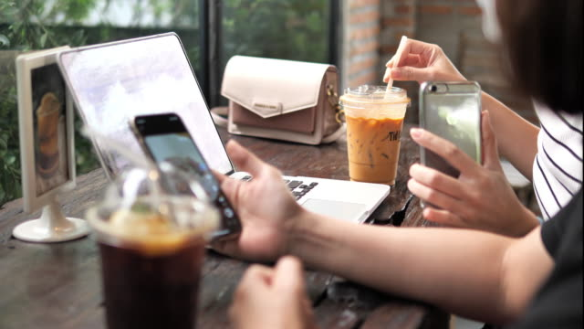 asian woman with hygienic mask using her laptop and working at coffee shop. - ordine video stock e b–roll