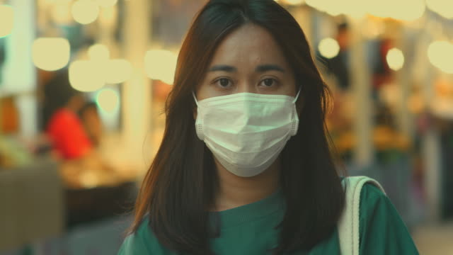 asian woman with hygienic mask - dividing stock videos & royalty-free footage