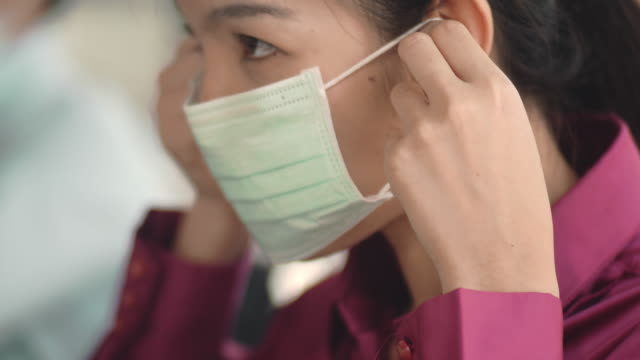 asian woman with hygienic mask - applying stock videos & royalty-free footage