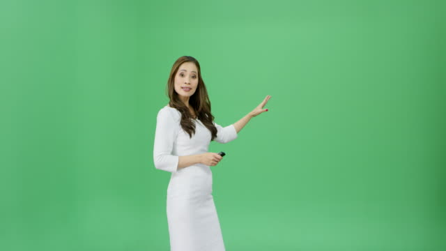 asian woman with long hair presenting the weather forecast - explaining stock videos & royalty-free footage