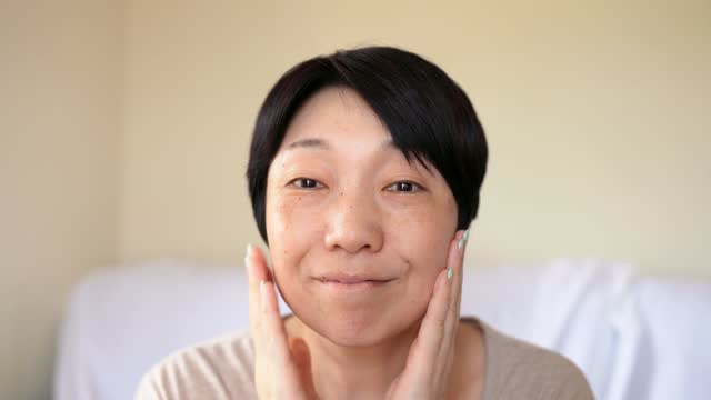 asian woman with no make up looking in the mirror - no make up stock videos & royalty-free footage