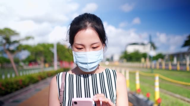 asian woman with protective face mask commuting in the city - public transport stock videos & royalty-free footage