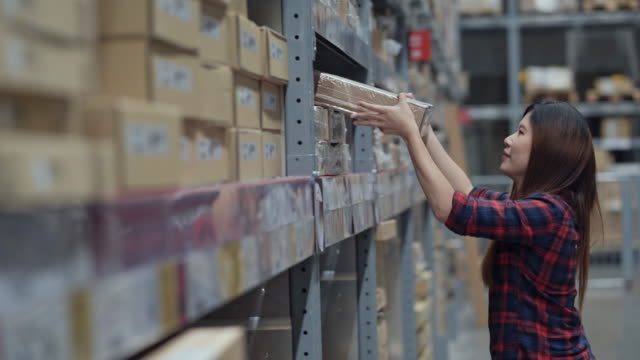 asian woman worker lifting goods stock in warehouse inventory - cardboard box stock videos & royalty-free footage