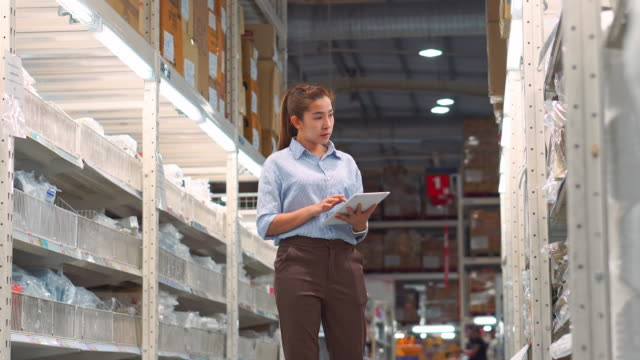 asian woman worker working using tablet checking boxes logistic import and export supplies packages in warehouse , logistics concept - non us location stock videos & royalty-free footage