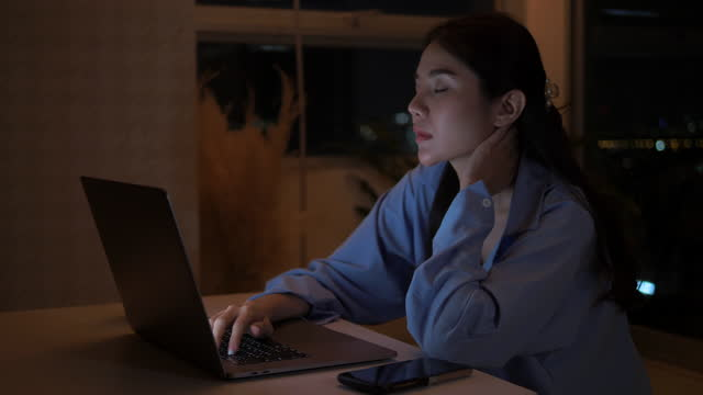 asian woman working late - classified ad stock videos & royalty-free footage