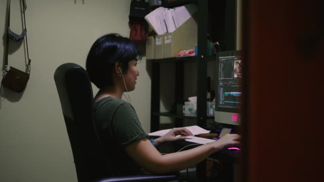 asian woman working on laptop at home - small office stock videos & royalty-free footage