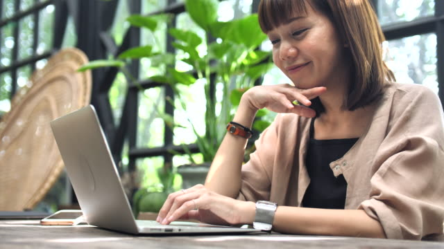 Asian Woman Working with Laptop