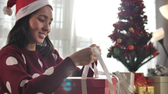 asian woman wrapping gift on christmas at home preparing for xmas celebration - wrapped stock videos & royalty-free footage