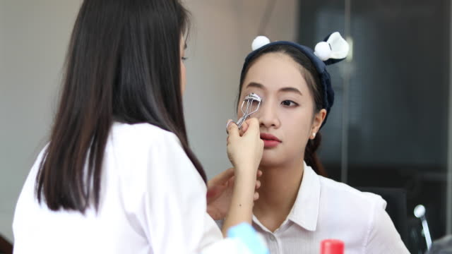 Asian women Applying Make-Up