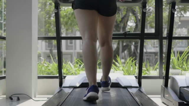 asian women are exercising in the gym using the treadmill. - cross trainer stock videos & royalty-free footage