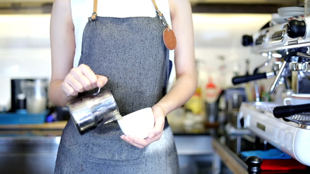 asian women barista smiling and holding coffee cup and using machine in coffee shop counter - working woman small business owner food and drink cafe concept - coffee drink stock videos and b-roll footage
