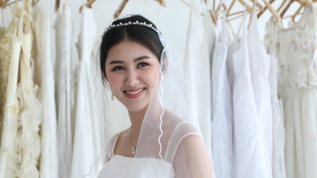 asian women beautiful bride put her jewelry and wedding earrings - bride stock videos & royalty-free footage