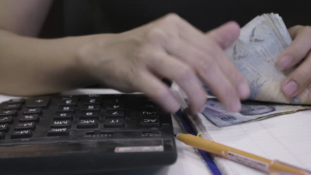 asian women counting money thai baht on her workplace in home - counting stock videos & royalty-free footage
