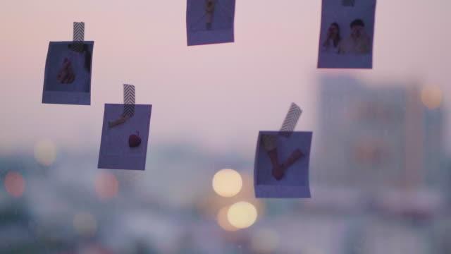 diy: asiatische frauen nach hause dekorieren mit foto - hängen stock-videos und b-roll-filmmaterial