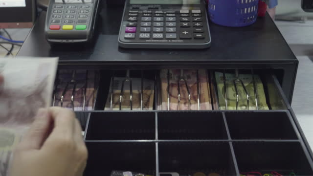 asian women dispensing change and counting from a register cash drawer - dime stock videos and b-roll footage