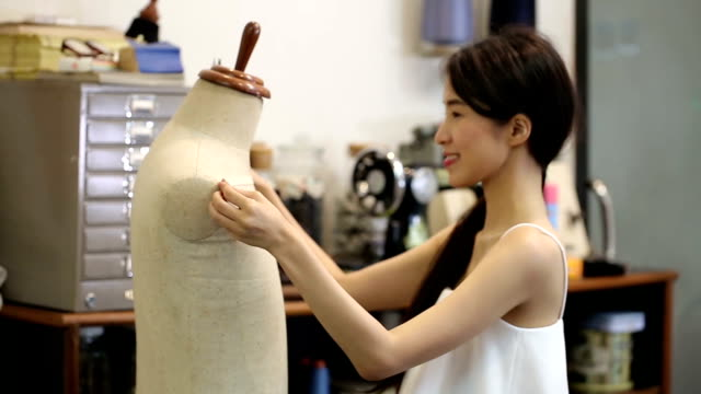 asian women fashion or designer with tailoring mannequin working cutting a roll of fabric - atelier fashion stock videos & royalty-free footage