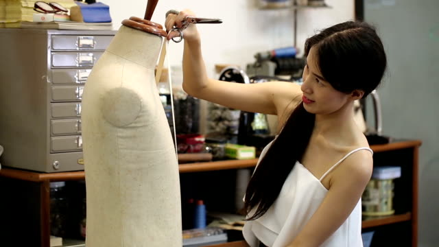 asian women fashion or designer with tailoring mannequin working cutting a roll of fabric - customised stock videos & royalty-free footage