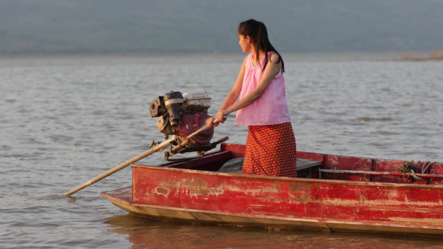asian women fisherman is driving a boat to catch fish - fisherman stock videos & royalty-free footage